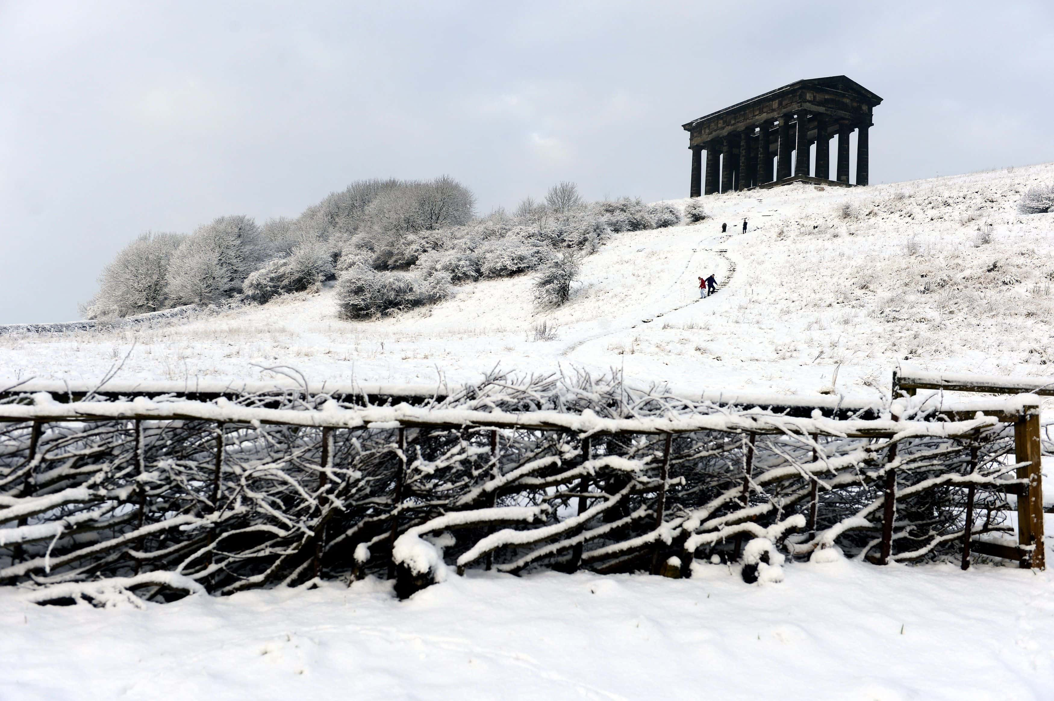 Sledgers make their way down the side of Penshaw Hill by Penshaw Monument in Sunderland today after heavy snow. Picture date: Tuesday January 15, 2013. Photo credit should read: Owen Humphreys/PA Wire.