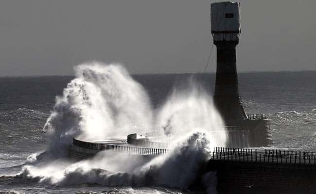 Photo by: Scott Heppell/AP/Press Association Images/ Heavy seas and waves crash over Roker pier at Sunderland, England, Thursday, Oct. 10, 2013. The Environment Agency has issued flood warnings for low lying roads and coastal land along the North East coastline.