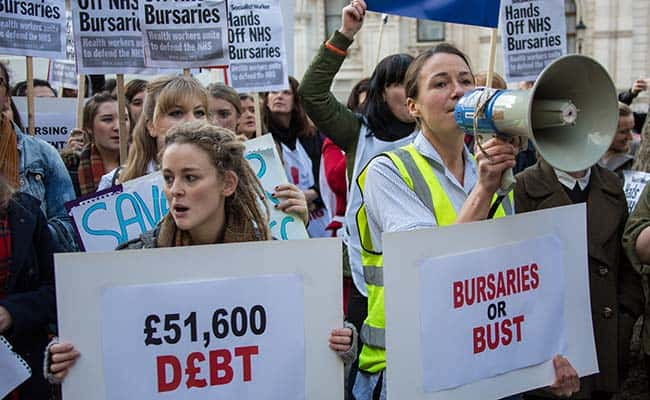 Health workers protested outside of the Department of Health against the Governments proposal to remove bursaries from student nurses, midwives therapists and radiographers. Health workers protest at Dept Of Health against NHS bursary cuts in December, 2015./David Rowe/Demotix/Press Association Images.