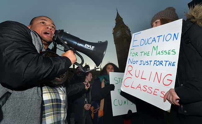 Protestors hold a demonstration against cuts to education maintenance grants on Westminster Bridge road, London/ Picture by: Anthony Devlin/PA Wire/Press Association Images.