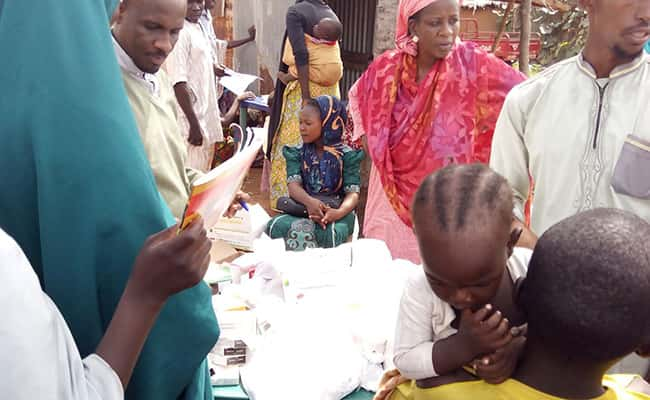 Dr. Attahiru Bello dispensing drugs during medical outreach in one of the internally displaced camps