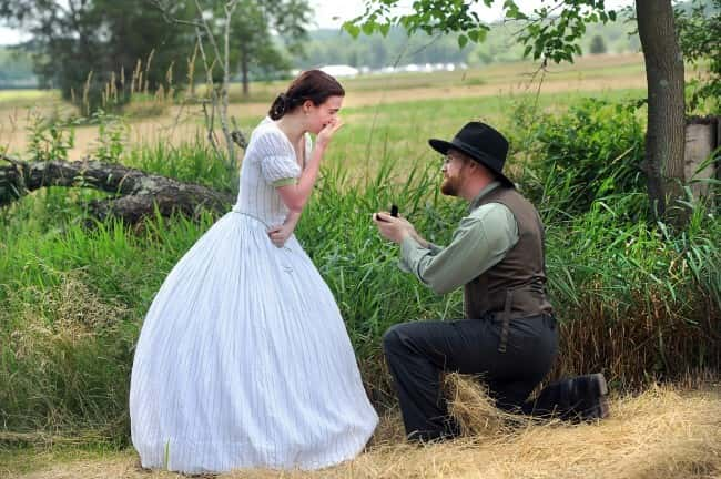 Re-enactor Patrick McCarthy, right, gets down on one knee to propose to his girlfriend Anna Jennings at the Gettysburg 150th celebration on  July 4, 2013./ Picture by: JASON PLOTKIN/AP/Press Association Images.