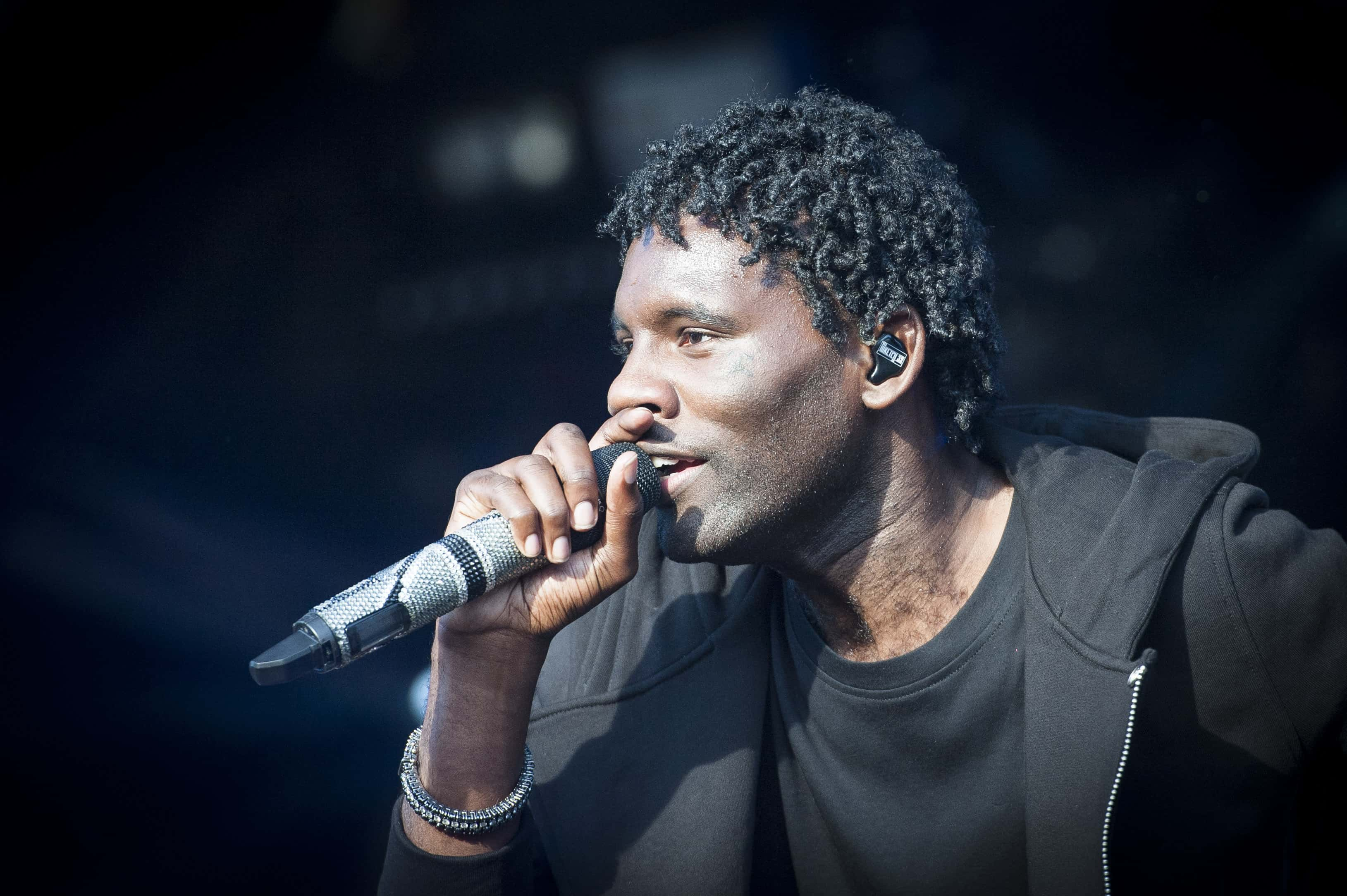 Wretch 32 performs live on stage on day 1 of Camp Bestival 2015, Lulworth Castle - Dorset.