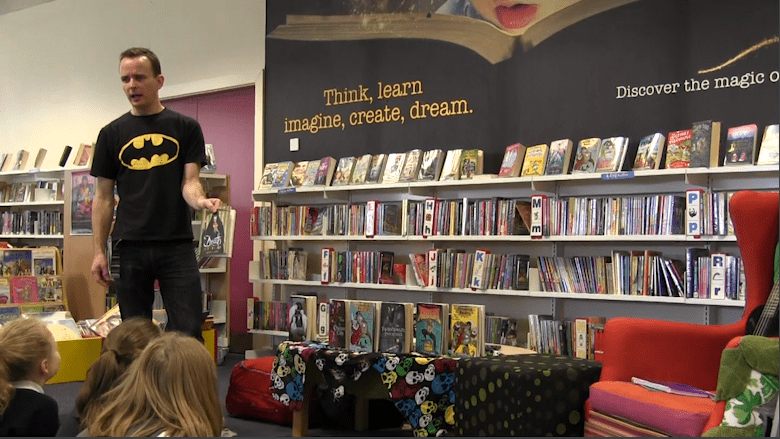 Award winning author performs to children