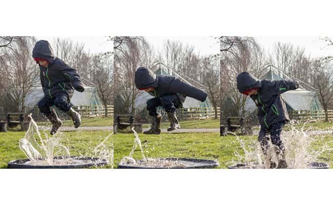Photo: A child puddle jumping by Nick-Brooks.