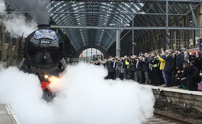 Shrouded in steam The Flying Scotsman train leaves Kings Cross railway station in London, as it begins its journey to York, Thursday, Feb. 25, 2016. The famous steam engine has undergone a 4.2 million pound sterling (US$ 5.845 million) decade long restoration, the engine was made in February 1923, and was the first locomotive officially to reach a speed of 100 miles per hour (161 Kph) in 1934. (AP Photo/Alastair Grant)