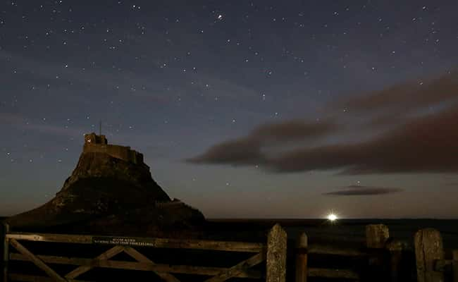 Picture by: Scott Heppell / AP/Press Association Images - A view of the stars above Lindisfarne Castle, after the Northern Lights also known as Aurora Borealis failed to be seen lighting up the sky above Holy Island, England.