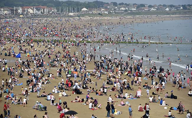 People enjoy the hot weather on the beach at Seaburn, Sunderland./Picture by: Owen Humphreys / PA Archive/Press Association Images.