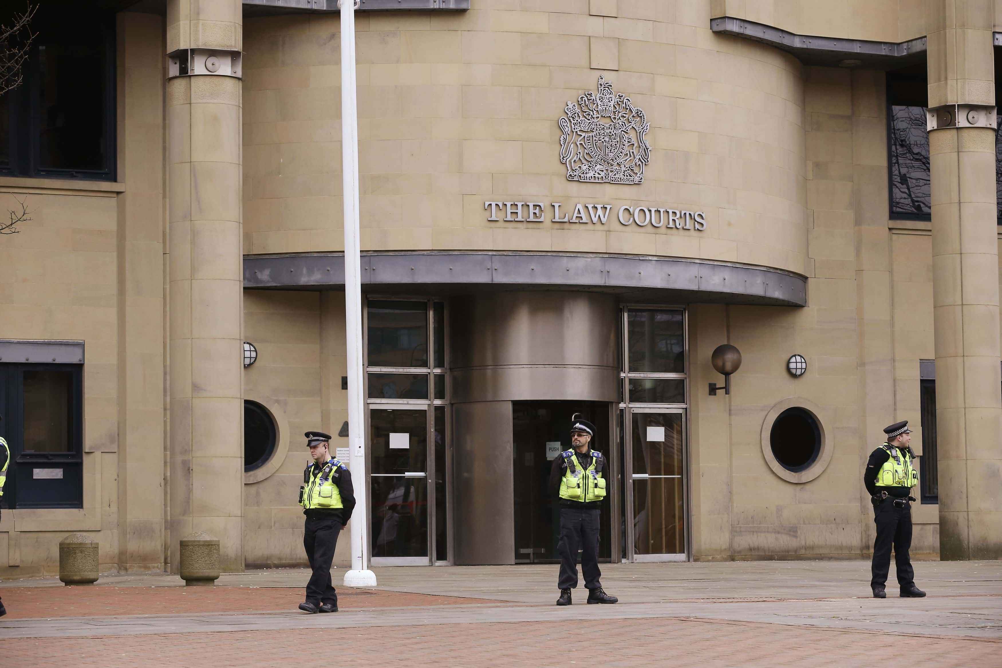 Police officers form a cordon ahead of the arrival of former England footballer Adam Johnson at Bradford Crown Court where he is expected to be jailed after he was found guilty of one offence of sexual activity with a child by a jury there earlier this month.