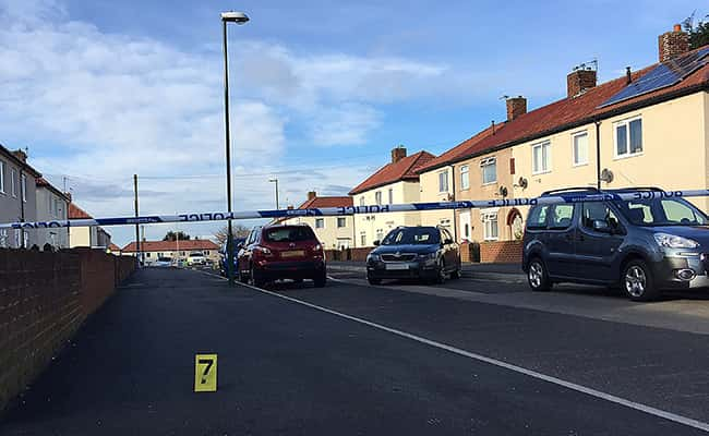 Photo: Cars parked close to the scene in Frenchmans Way, South Shields, South Tyneside, where police shot a man. Picture by: Tom Wilkinson / PA Wire/Press Association Images.