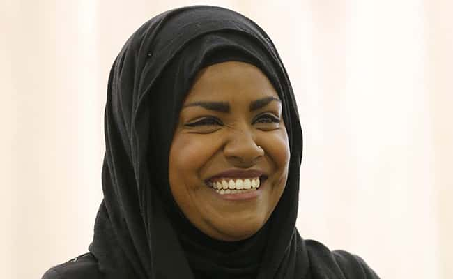 """The Great British Bake Off"" TV show winner Nadiya Hussain smiles as she poses for photographers in London, Thursday, Oct. 8, 2015. Nadiya Hussain was crowned winner of the contest Wednesday on a program watched by 13.4 million people, one in five of the British population and the biggest TV audience of the year./ Picture by: Frank Augstein / AP/Press Association Images."