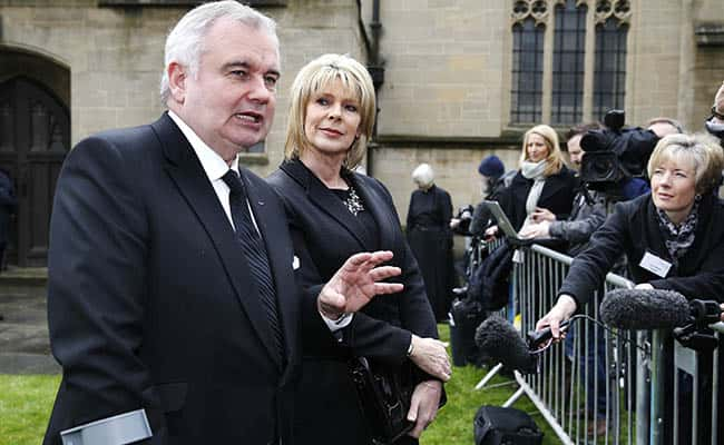 This Morning presenters Eamonn Holmes and wife Ruth Langsford speak to the media outside Sunderland Minster as they arrive for the funeral of TV agony aunt Denise Robertson./Picture by: Owen Humphreys / PA Wire/Press Association Images.