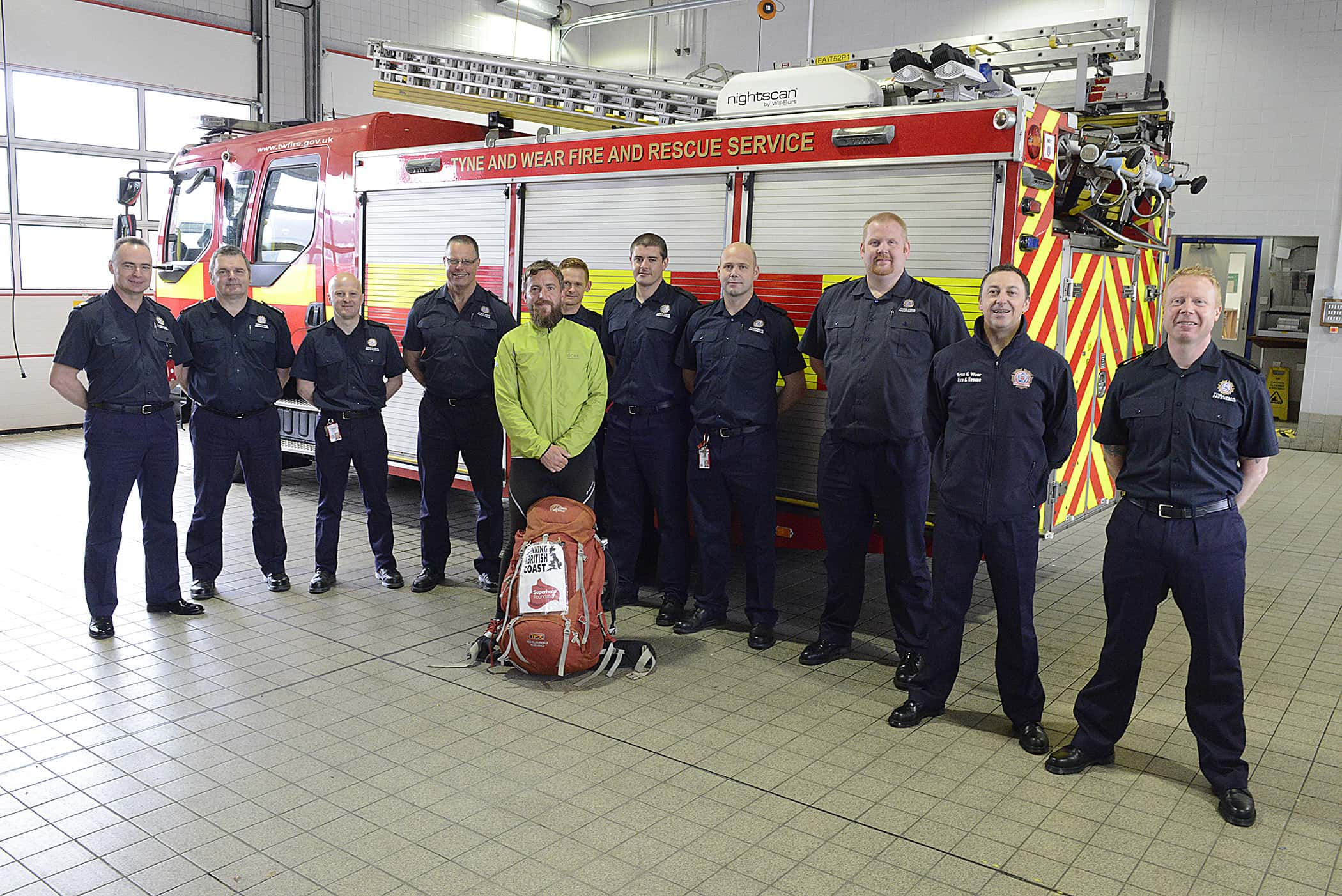 Epic charity runner Wayne Russell with firefighters at Sunderland Central Community Fire Station.