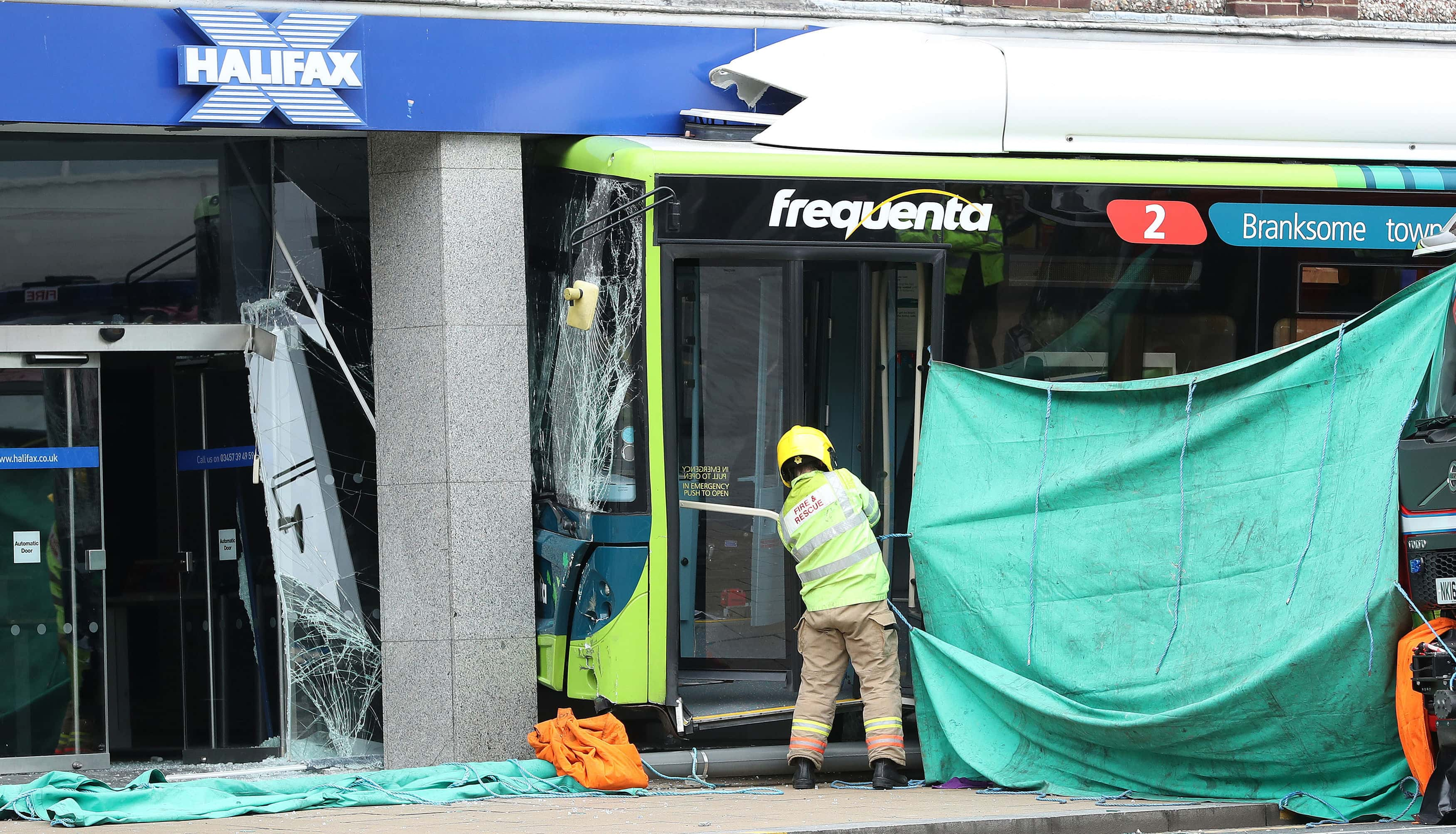 The scene in Darlington where an elderly female pedestrian has died after a bus crashed into a Halifax Bank branch.