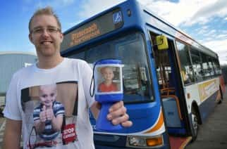 Ian Thompson with his fundraising shirt and collection tin.