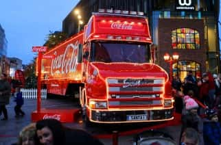 Shoppers pass the Christmas lights and the Coca-Cola truck at Liverpool 1 in Liverpool City Centre.