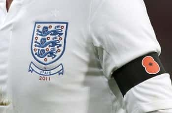 File photo dated 12/11/11 of an England player wearing a black armband with a poppy symbol. A Fifa ban on football players displaying poppies is insulting to British fans, chairman of the Commons Sports Committee Damian Collins has said.