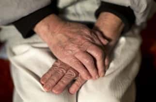 File photo dated 17/03/1 of the hands of an elderly woman. Dementia and Alzheimer's disease has become the leading cause of death in England and Wales for the first time, new figures show.