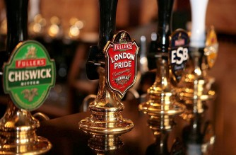 """File photo dated 06/06/08 of beer taps inside The Counting House pub in the City of London, as Fuller, Smith and Turner said its pubs and hotels business """"outperformed the market"""", but saw beer and cider sales slide 4%."""