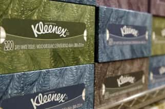 In this Jan. 20, 2011 photo, boxes of Kleenex tissues, a Kimberly Clark brand, sit on the shelf at a store in San Francisco. Kimberly-Clark Corp., maker of Kleenex, Huggies and other well-known household brands, said Monday, Oct. 24, 2011, that its net income fell 8 percent in the third quarter because of rising costs. It also cut its revenue outlook and the high end of its earnings outlook. (AP Photo/Jeff Chiu)