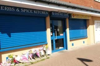 BEST QUALITY AVAILABLE Flowers are left outside Herbs n Spice Kitchen in South Shields, South Tyneside, where Tipu Sultan, 32, was shot.
