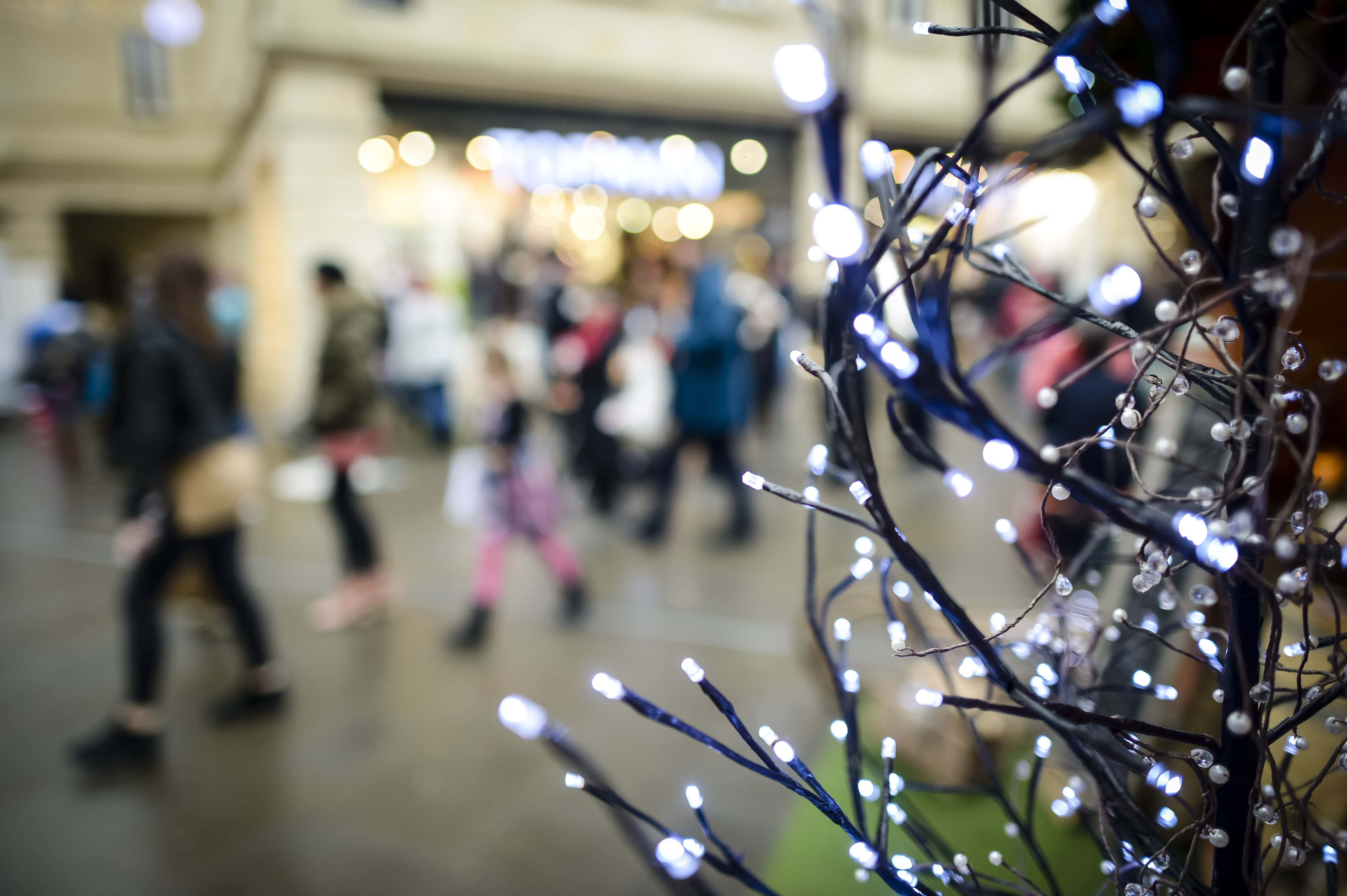 Fairy lights in Bath, as panic-buyers and bargain-hunters are expected to flood stores on the busiest day in the Christmas shopping calendar today, with high street shops slashing prices in an attempt to coax consumers down the aisles.