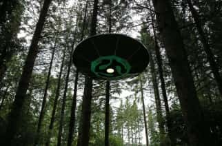 A UFO prop hanging from trees in the forest during a press preview of the Electric Picnic festival in Stradbally, County Laois.