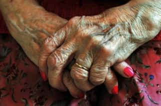"""File photo dated 05/12/08 of the hands of an elderly woman, as the country is on the brink of a """"social care crisis"""" if funding for the care of the elderly is not improved, the Government has been warned."""
