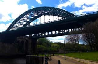 The Wearmouth bridge from below it walking along the River Wear. Used photoshop to crop, straighten and brighten the image.