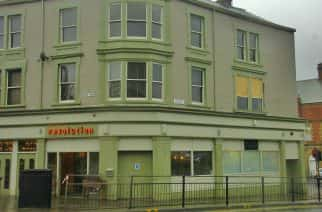 Revolution bar in Sunderland and the broken window. (Photo by Ryan Lim)