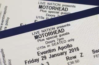 "Two tickets for the upcoming concert for Motorhead are displayed, in London, Tuesday, Dec. 29, 2015. Ian ""Lemmy"" Kilmister , the singer and bassist of Motorhead died Monday at age 70 after a brief battle with aggressive cancer, said his agent Andrew Goodfriend. Kilmister had learned of the diagnosis just two days earlier, according to a statement from the band, and he had also suffered several other health issues in recent months. (AP Photo/Alastair Grant)"