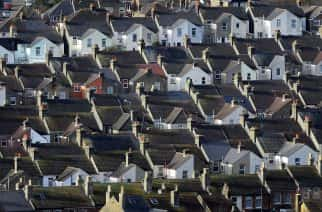 File photo dated 13/01/16 of houses, as house prices dipped for the first time in five months in January, according to an index.