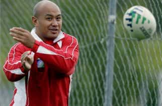 Nili Latu captain of the Tongan team passes the ball during a team training session in Clapiers, southern France Wednesday Sept. 26, 2007 as they prepare for their Rugby World Cup Group A game against England, in Paris later this week, (AP Photo/Mark Baker)