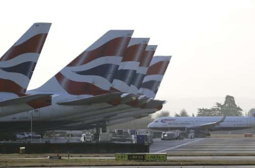 British Airways planes with their tail fin wait at Heathrow Airport during a 48hr cabin crew strike in London, Tuesday, Jan. 10, 2017. (AP Photo/Frank Augstein)