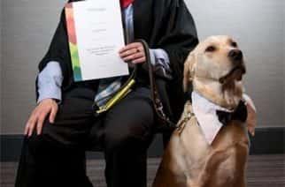 Craig Blackbird and Commando on their graduation from Sunderland College.