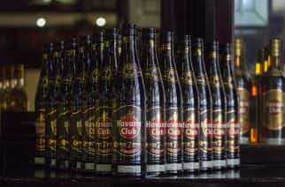 HOLD FOR CUBA RUM DISPUTE STORY BY JENNIFER KAY - Bottles of Cuban Havana Club rum are displayed at the bar in the Rum Museum in Havana, Cuba, Wednesday, June 8, 2016. (AP Photo/Desmond Boylan)