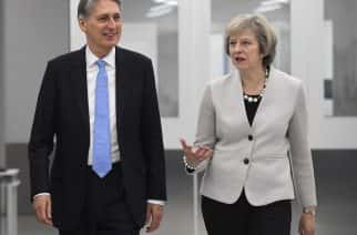 """File photo dated 24/11/16 of Prime Minister Theresa May and Chancellor Philip Hammond, as Mrs May said that the Chancellor will listen to concerns raised by Tory MPs about the Budget's controversial National Insurance hike, but defended the change as """"fair""""."""