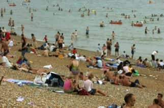 People at Brighton beach enjoy the end of the weekend near to Brighton Pier.  20/03/04: According to research, South West England is the most popular destination for Britons taking a holiday, but northern city dwellers prefer Wales and Londoners escape to the South Coast. A report by teletextholidays.co.uk showed that the pleasures of Blackpool, Brighton and Bournemouth were proving increasingly popular with Britons. 29/06/2004: Britons are bashful about stripping off on UK beaches, a survey revealed Tuesday June 29, 2004.  When it comes to baring all, 52% of respondents said they would not feel confident stripping down to their swimsuits on a beach in the UK, although they would abroad. Only 22%.  10/08/2004  Torrential rain and storms continued to bring misery to much of Britain Tuesday August 10, 2004, a year to the day after temperatures reached a record breaking high amid glorious sunshine. The deluge which brought flash flooding and dangerous levels of surface water on roads was in stark contrast to the baking 38.1C (100.6F) enjoyed in Gravesend, Kent, on this day last year during a record a breaking spell of dry, sunny weather.