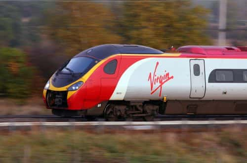 File photo dated 21/10/09 of a Virgin train as Virgin Trains passengers will receive money directly on to their payment cards within three days if their journey is delayed by at least half an hour.