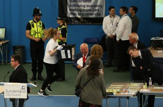 Election staff run with ballot boxes as the General Election count gets underway at Silksworth Community Centre in Sunderland. PRESS ASSOCIATION Photo. Picture date: Thursday June 8, 2017. See PA story ELECTION Main. Photo credit should read: Nigel Roddis/PA Wire