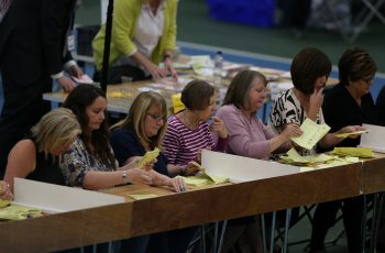 Election staff count ballot papers for the General Election at Silksworth Community Centre in Sunderland. Nigel Roddis/PA Wire