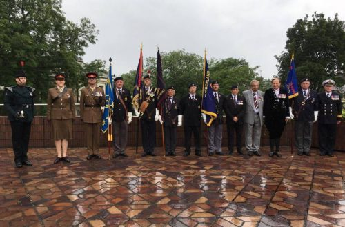 Members of the Armed Forces with their ceremonial flags/photo by Sophie Dishman.