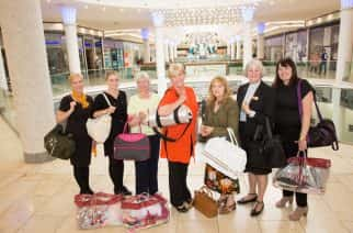 Bags of support: Jill Smith (centre, wearing orange), with president of Soroptimists Newcastle Club with fellow club members collecting New Start Bags from intu Metrocentre staff, including Chaplain Lyn Jamieson (second right). Photo by Intu Metrocentre.
