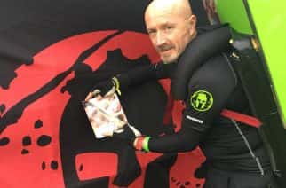 We're Here: Tony Phoenix Morrison with a picture of Chloe and Liam after the Spartan Beast race in July 2017/photo credit: Tony Phoenix Morrison.