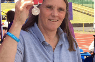 Ann Walsh receiving British Empire Medal