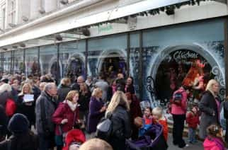 EDITORIAL USE ONLY: Crowds gather as Fenwick, Newcastle unveils its Fairy Tale Forest themed Christmas window.