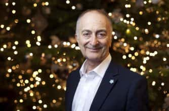 EDITORIAL USE ONLY Sir Tony Robinson at the AlzheimerÕs SocietyÕs Christmas Carol service at St PaulÕs Church in Kensington, London.