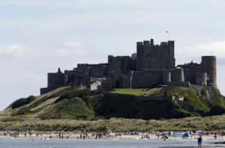 People enjoying the sunshine at Bamburgh Castle in Northumberland.