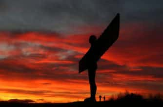The sun sets behind the Angel of the North in Gateshead, Tyne and Wear, after England and Wales experienced the coldest night of the season with temperatures dropping as low as minus 9.4C (15F), the Met Office said.