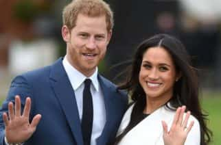 Prince Harry and Meghan Markle pictured outside of Kensington Palace